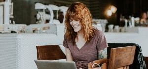 woman with tatoo writes business plan